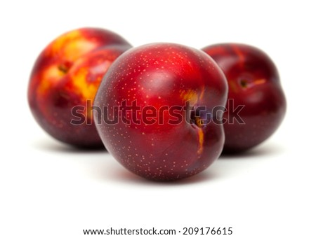 ripe dark red plums fruit isolated on white - stock photo