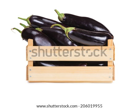 Ripe eggplant in a wooden box isolated on white background.  - stock photo