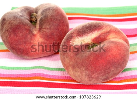 ripe fig peaches on napkin isolated on white