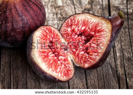Ripe fig splitted in half - close up - stock photo