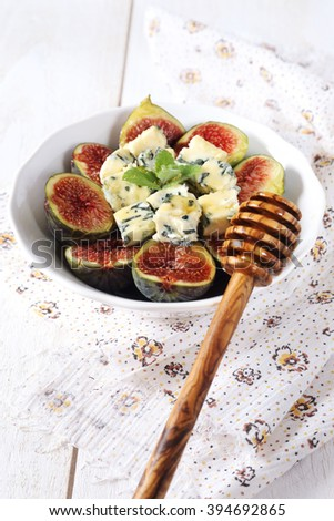 Ripe figs, blue cheese and honey - stock photo