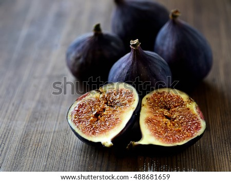 ripe figs on a wooden background