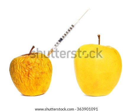 Ripe fresh apple fruit and wrinkled peel apple fruit getting rejuvenation injection procedure. Rejuvenation concept ( Aging concept. Botox injection concept.) White background isolated  - stock photo