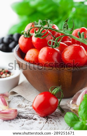 Ripe fresh cherry tomatoes on rustic white wooden background, selective focus - stock photo