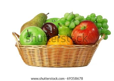 Ripe fresh fruit in basket isolated on white background - stock photo