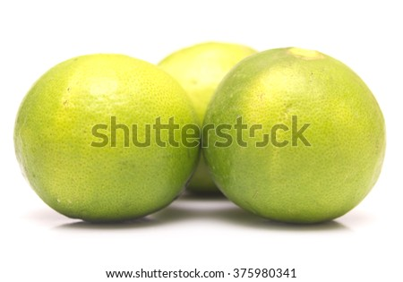 ripe fresh limes isolated on white background - stock photo
