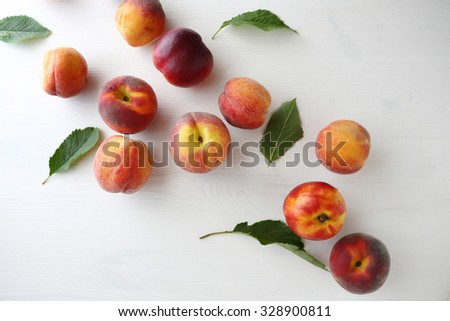 ripe fresh organic peaches, top view - stock photo