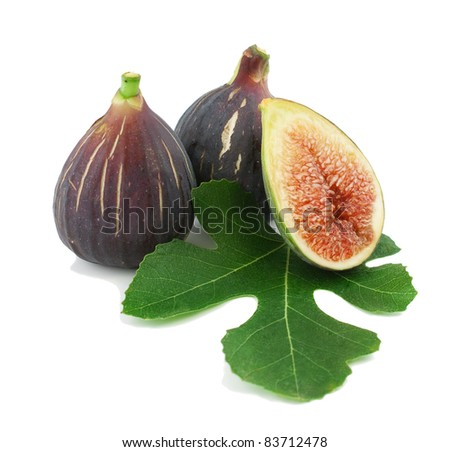 Ripe fresh purple fig fruits  and leaf on white background - stock photo