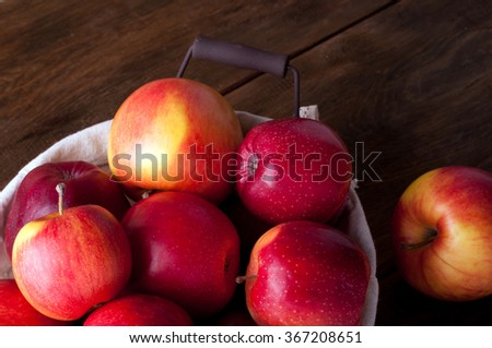 Ripe fresh red apples on a brown wooden background - stock photo