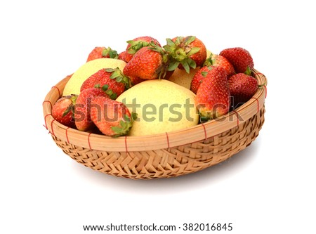 Ripe fresh strawberries on plate close up on white background