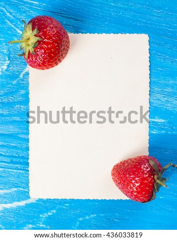 Ripe fresh strawberry with card on a wood desk. Nature background - stock photo