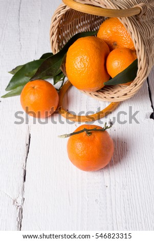 Ripe fresh tangerines on a white wooden table