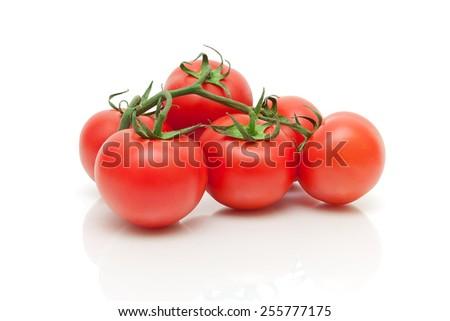 ripe fresh tomatoes closeup on a white background. horizontal photo. - stock photo