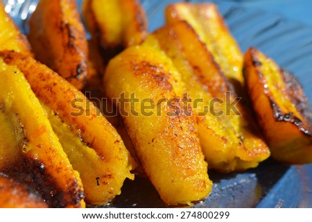 Ripe fried plantain - local banana served for breakfast or separately with sour cream in Guatemala and other countries of Central America - stock photo