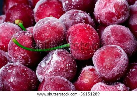 Ripe frozen sweet cherry close up. - stock photo
