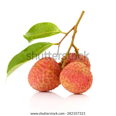 Ripe fruit of the lychee (Litchi chinensis) against white background - stock photo