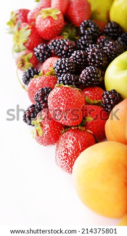 Ripe fruits and berries isolated on white