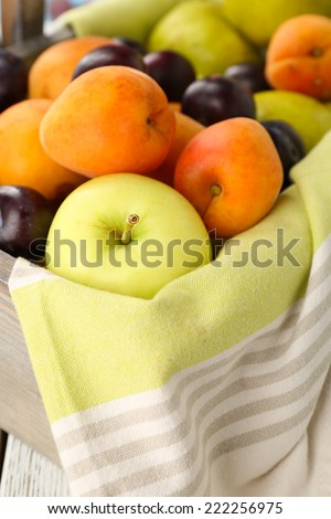 Ripe fruits in crate close up - stock photo