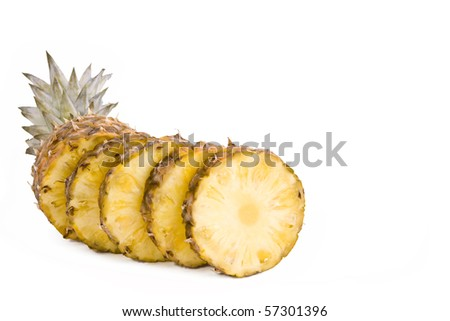 Ripe fruits pineapple with slices isolated on white