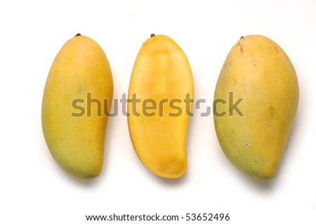 Ripe golden mangoes - stock photo