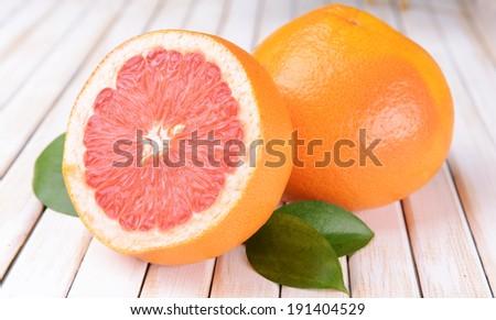 Ripe grapefruit on table close-up - stock photo