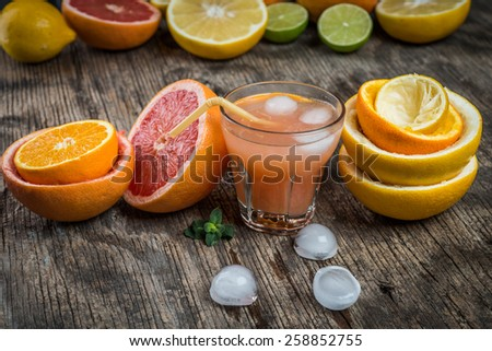 Ripe grapefruit with juice on table  - stock photo