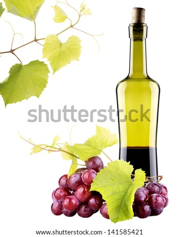 Ripe grapes and bottle of wine isolated on white - stock photo