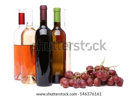 Ripe grapes and bottles of wine - stock photo