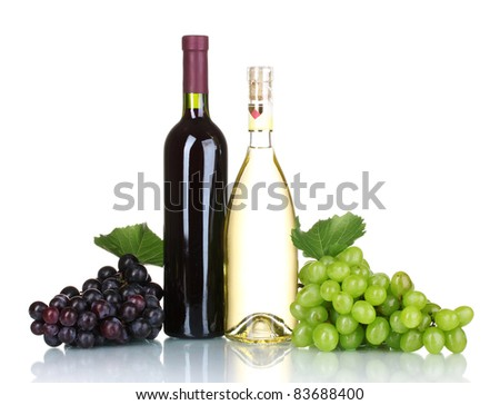 Ripe grapes and bottles of wine isolated on white - stock photo