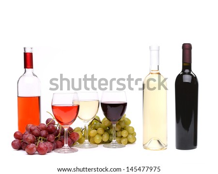 Ripe grapes, glasses and bottles of wine - stock photo