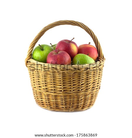 Ripe green and red apples in brown wicker basket isolated on white closeup - stock photo