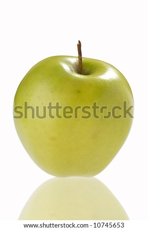 Ripe green apple with reflection on the white background