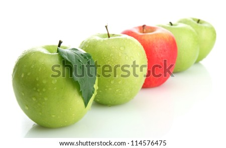 Ripe green apples and one red apple isolated on white - stock photo
