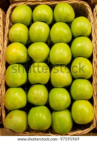 Ripe green apples in a basket - stock photo