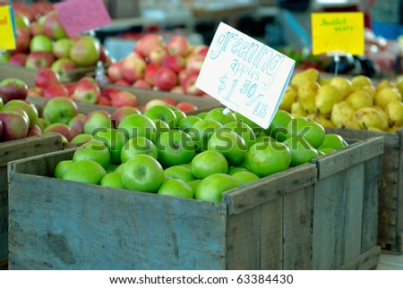 Ripe green apples in box with a price tag - stock photo