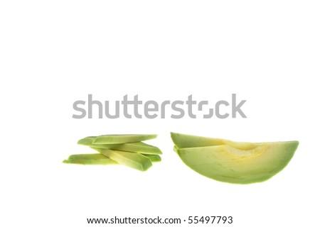ripe green avocado slice over white isloated - stock photo