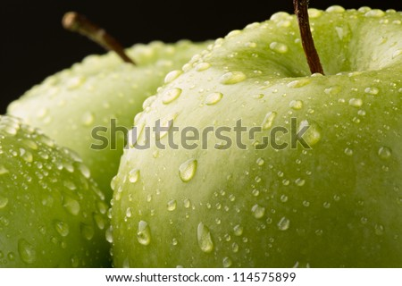 Ripe green Granny Smith Apple with water drops - stock photo