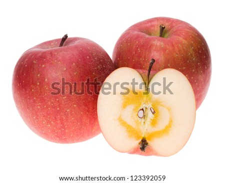 Ripe Japanese San-Fuji apples with one cut in half - stock photo