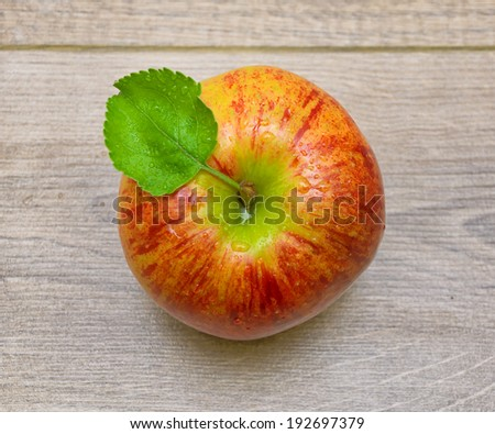 ripe juicy apple closeup on wooden background. top view - horizontal photo. - stock photo