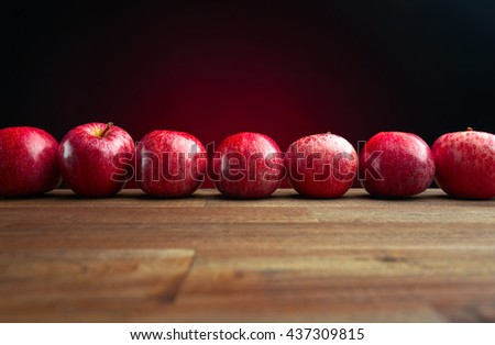 ripe juicy apples on a wooden table - stock photo