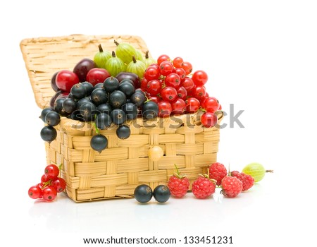 ripe juicy berries in a wicker basket on a white background - stock photo