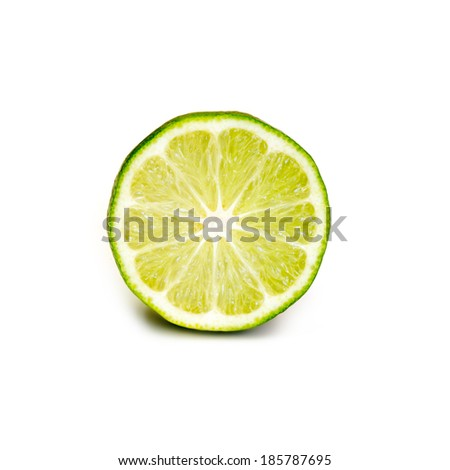 Ripe juicy cut lime isolated on white background - stock photo