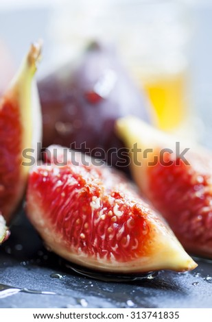 Ripe juicy figs with honey, selective focus - stock photo