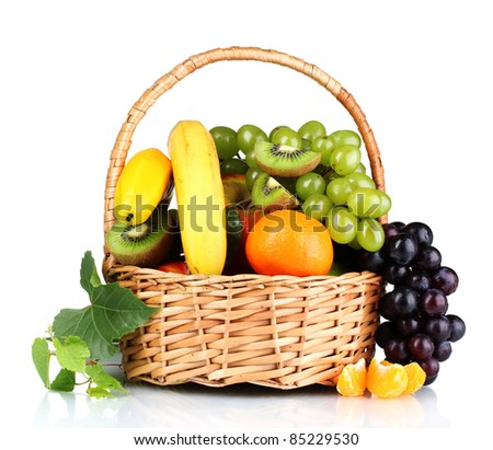 Ripe juicy fruits in  basket isolated on white - stock photo