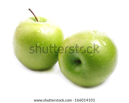 Ripe juicy green apple isolated on white.