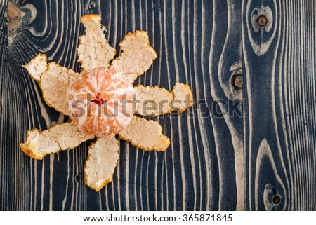 Ripe juicy mandarin fruit on blue wooden background - stock photo