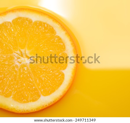 Ripe Juicy Orange Slice in the Juice - stock photo