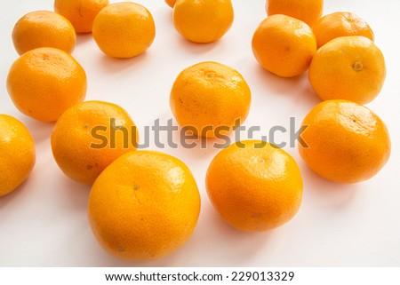 Ripe juicy orange tangerine or mandarin fruit on white background - stock photo