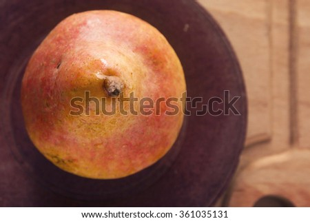 Ripe juicy pear on a wooden board Close Up - stock photo