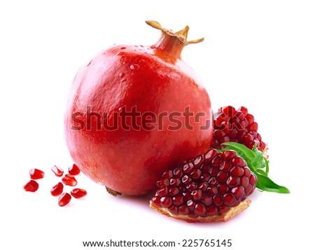 Ripe juicy pomegranate on white background. - stock photo